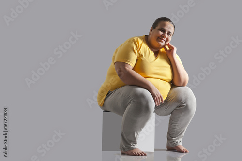 Fotografie, Obraz  Portrait of an obese woman sitting