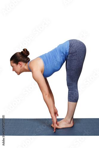 Woman doing yoga asana Uttanasana - standing forward bend Wallpaper Mural