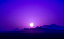 View On Purple Sunrise Over Mountains In Dessert Of Iran
