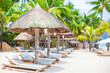 Beach beds on luxury resort on exotic tropical white sandy beach