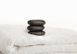 Stacked massage stones on a towel