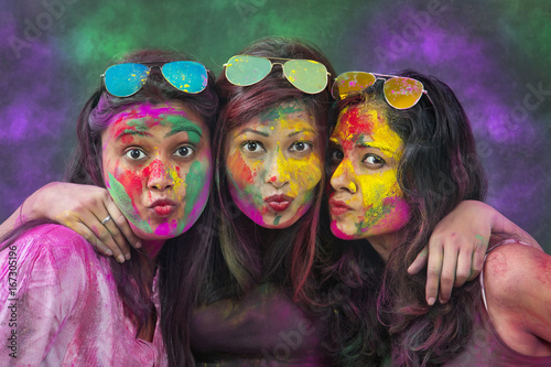 Portrait Of Three Young Indian Women With Colored Face Dancing During Holi Color Wallpaper Mural