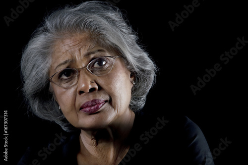 Fotografija Portrait of an old woman with eye glasses