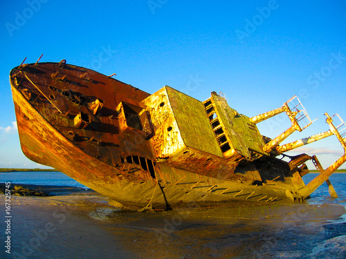 Photo Stands Shipwreck An old grounded shipwreck on a beach in Mozambique