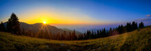 Panorama Of A Sunrise Over A Musty Mountains And Pine Forest During Late Summer
