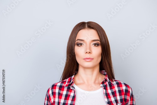 Close up portrait of serious young freelancer brunette lady, she stands in check Tablou Canvas