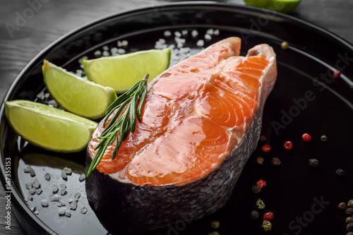 Fotografie, Obraz  Fresh salmon steak with slices of lime on baking dish