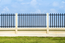 Beautiful Of Fence Factory In Industrial Estate,green Field And Stone With Blue Sky And Cloud As Background
