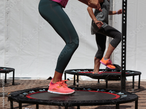Fotografía  Mini Trampoline Workout: Girl doing Fitness Exercise in Class at Gym