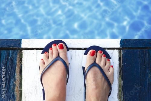 Female feet on jetty