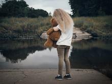 Sad Child Hugging A Toy Teddy ...