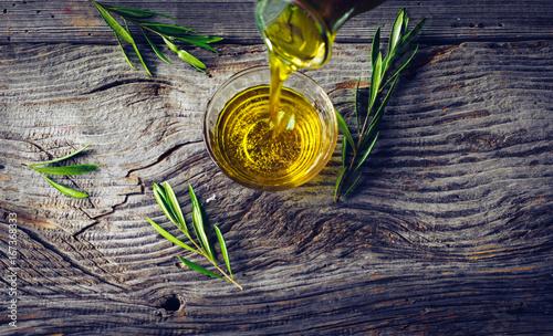 Fototapeta Olive oil with olive twig obraz