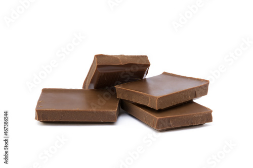 Aluminium Prints Grocery Milk chocolate pieces isolated on white background