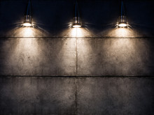 Background Image Of A Dark Wall With Three Lamps Above