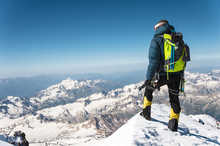 Professional Guide - Climber On The Snow-covered Summit Of Elbrus Sleeping Volcano