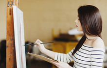 Art Student Drawing A Painting