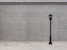 The Lamp On The Footpath And The Wall In The Dim Atmosphere.