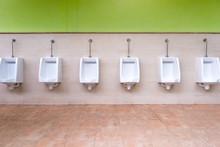 White Urinal In Men's Bathroom.