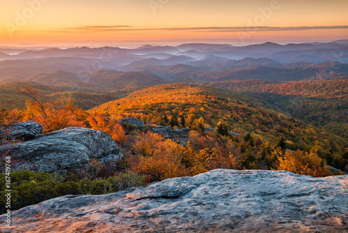 Scenic sunrise over fall foliage, Blue Ridge Mountains, North Carolina.