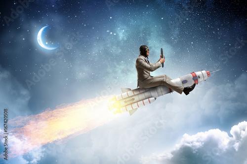 Fotografiet  Aviator riding rocket. Mixed media