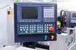CNC machine with controller console in factory