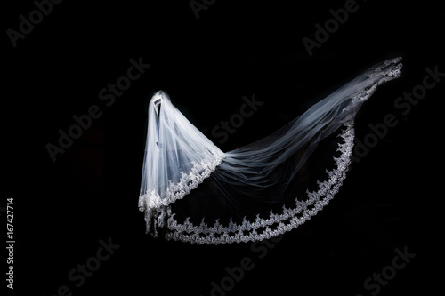 Obraz na plátně  wedding white Bridal veil on black background isolated