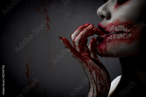 Photo  Zombie women death the ghost drain hand blood skin is screaming darkness and nightmare background, horror of scary fear on hell is monster devil girl in halloween festival concept,copy space the left