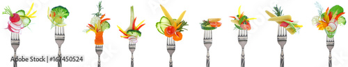 Poster Légumes frais Variety of fresh vegetables on forks - white background