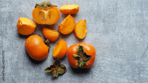 Ripe persimmon fruit on rustic table, tropical fruit Canvas Print