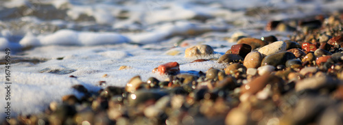 Fotobehang Macrofotografie Waves washing over gravel beach, macro shot.