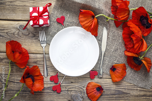 Romantic Table Setting With Cutlery And Red Poppies On Rustic Wooden