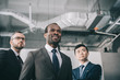 group of modern stylish multiethic businessmen