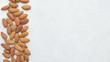 dried almonds on white grey background
