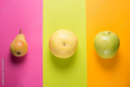 Fruits on striped colorful background - 167464372