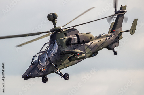 Photo Military attack helicopter in flight