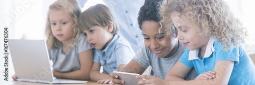 Fotografia Children using laptop and smarthopne
