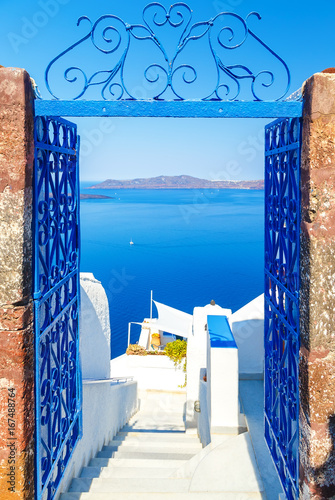 Fototapeta View to the sea and Volcano through door, from Fira the capital of Santorini island in Greece obraz