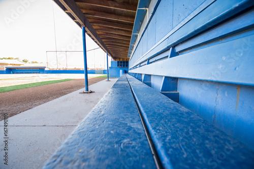 Fotografiet  Baseball Field Dugout Bench