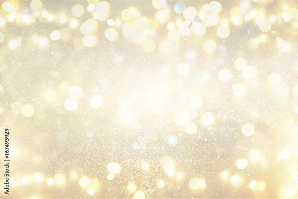 glitter vintage lights background. silver and light gold. de-focused