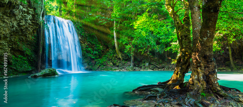 Staande foto Watervallen The beautiful waterfall at deep tropical rain forest.