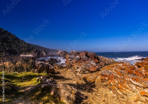 Foto op Plexiglas Donkerblauw Landscape of part of the Otter Trail at the Indian Ocean