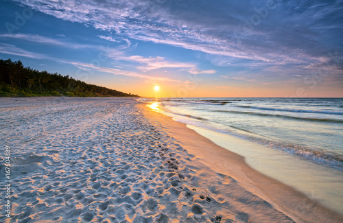 Sunset on the beach on the Baltic Sea. HDR - high dynamic range