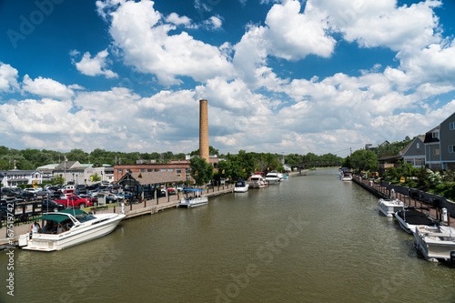 Fényképezés Erie canal with boats and buildings on a summer day in Fairport, New York