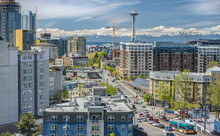 Downtown Seattle City Streets And Olympic Mountains