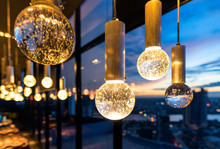 Luxury Interiors Of Chandelier Light Pattern Background In Modern Building.