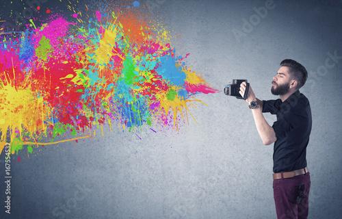 Fototapeta Hipster guy with camera and paint splash obraz na płótnie