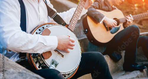 Fotografie, Obraz View of musician playing banjo at the street