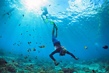 Happy Family Vacation. Man In Snorkeling Mask With Camera Dive Underwater With Tropical Fishes In Coral Reef Sea Pool. Travel Lifestyle, Water Sport Outdoor Adventure, Swimming On Summer Beach Holiday