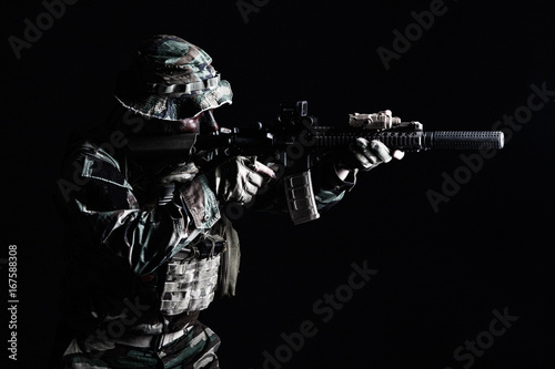 Bearded Special forces United States in Camouflage Uniforms studio shot half length black background, backlit Wallpaper Mural