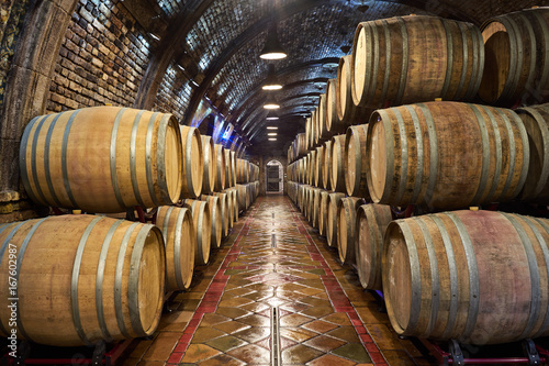 Fotografiet Wine cellar with of oak barrels